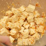 Sprinkle sesame seeds over the marinated tofu and toss well.