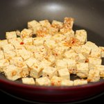 Stir in the marinated tofu and cook...