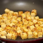 After about 8 minutes, tofu cubes turn into golden and slight brown...