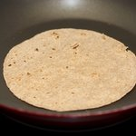 Put 1 tortilla in the skillet and toast until soft and puffed slightly at edges, 1 minute...