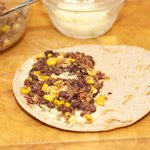 Add half of the corn and bean fillings on top of the cheese...