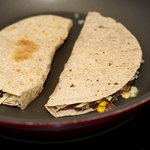 Arrange both quesadillas in the skillet, oiled sides down...