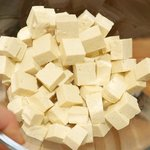 Place all the tofu cubes in a large bowl...