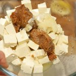 Toss tofu with the marinade...