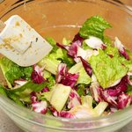 Give it a good toss until almost all the leaves are evenly coated by the delicious dressing.