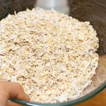 In a large bowl, stir oats and coconut until well distributed.