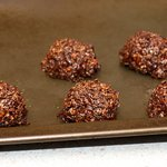 With a large spoon, make cookies on oiled sheet.