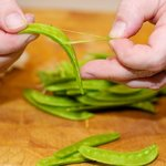Remove the strings from the snow peas