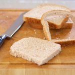Trim off the edges of bread...