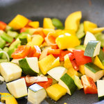 Diced colourful vegetables in skillet