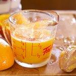 Squeeze the orange juice into a measuring cup...