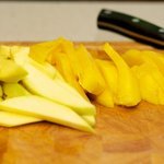 Slice the mangos into about 1/2-inch thick slices...