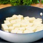 Add the paneer cubes to a hot pan (with a bit of oil)
