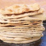 Keep repeating the same steps until all the small balls turn into these lovely naan breads...