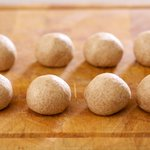 Divide the rested chapti dough into 8 equal balls