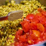 Add the cumin seeds, tomato, stir and cook for 3 to 4 minutes.