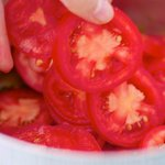 then add the sliced tomatoes...