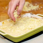 Sprinkle the cheese evenly over baked scalloped potatoes...