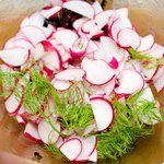 add the sliced radishes and chopped fennel fronds...