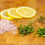 Slice the lemon and prep the herbs, don't forget to keep the stems!