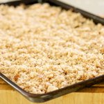 Spread the bread crumbs on a rimmed baking sheet