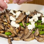 Place the aspragus, mushrooms and goat cheese onto a large platter.
