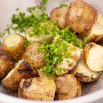 Toss the hot grilled potatoes...
