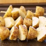 Brush all sides of the cooked and cooled potatoes with the olive oil or any vegetable oil, and sprinkle with salt and black pepper to taste.