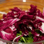 add the well washed and spinned radicchio into the same mixing bowl too.