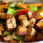 Pour the mixed sauce into the cooked vegetables, stir in the cooked tofu cubes,