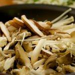Stir in the prepared assorted mushrooms.