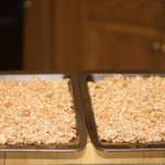 Spread mixture evenly between two baking sheets.
