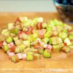 Drain, pat dry with the paper towels, and slice rhubarb crosswise into the 1/2-inch thick slices.