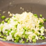 Add the garlic, ginger and scallions into the same hot wok or skillet with the remaining oil added.
