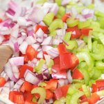 Add the celery, bell pepper and onions into the bowl.
