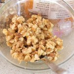 Mix the coarsely chopped walnuts with 2 tablespoons honey.