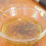 Add the vinegar, mustard, honey, cumin, salt and black pepper into a small bowl.