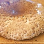 With a sharp knife, cut 1/4-inch slits, spaced 1/2-inch apart, in the crosshatch patten on the surface of 8 mushrooms.
