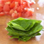 Now stack the fresh basil leaves from your backyard or grocery store together like I did.