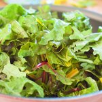 Increase the heat to medium high, stir in the chopped kale or chard and a pinch of salt,
