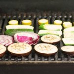 Using a tongs place the vegetables on the preheated griller.