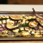 Remove the grilled vegetables onto the baking sheet.