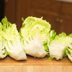 Then quarter the cabbage.