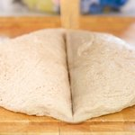 Transfer the dough gently onto the floured cutting board, try not to deflate the dough.