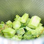Steam both broccoli florets and peeled stems in a basket over a pot filled with about 1-inch water.