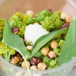 Place the steamed broccoli, sage, toasted hazelnuts in a food processor.