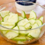 Toss the cucumber slices with a little bit salt in a small bowl. Set aside for about 10 minutes.