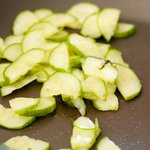 Heat the vegetable oil in a nonstick skillet over medium heat and add cucumber,
