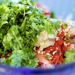 Add the radishes, freshly chopped cilantros, chili peppers, a little garlic, sesame oil and sesame seeds into a bowl.