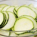 All the zucchinis have been beautifully sliced, place into a large bowl.